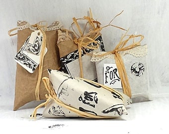 Custom Gift Wrap and Protective Cases. This is #3.) Vintage stamped crafted paper, lace, straw trimming