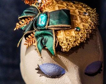 Beautiful Facinator Hat / Headpiece Golden - tan shades with emerald green bow and rhinestone