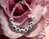 Cute beads bracelet with letterbeads and swarovski beads. Can be customized