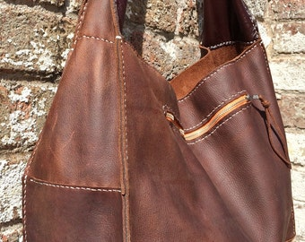 Leather tote with shoulder strap.