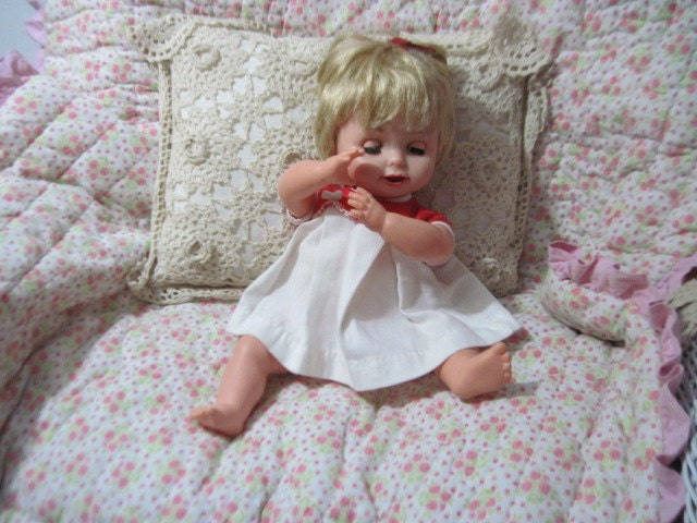 Pouting Baby Dolls Reading Baby Magic Doll