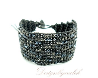 Black crystal hand knotted on cotton bracelet.