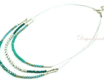 Blue color crystal on silk necklace.