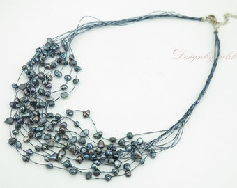 Black freshwater pearl on silk necklace.