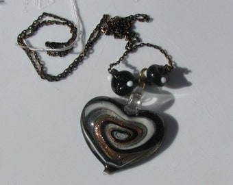 Black, white, silver and copper swirl fused glass heart necklace