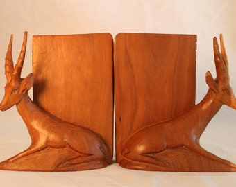 Elegant, hand-carved, wooden bookends. Hand-carved, wooden Kenyan bookends. African bookends. Gazelle bookends. Antelope bookends.