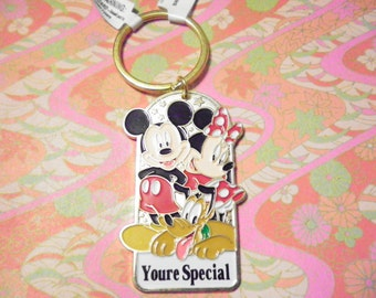 2 Disney Signed Mickey Mouse,  Minnie Mouse and Pluto Keyrings