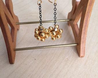Sweet Gold Glass Blossom on Black Chain Dangle Earrings