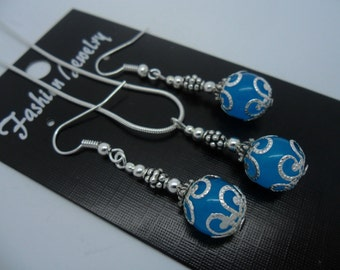 A hand made sky blue jade bead necklace and earring set.
