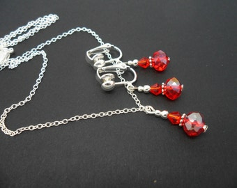 A hand made red crystal bead  necklace and  clip on earring set.