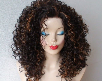 Lace front wig. Brown hair with auburn highlight  deep curly Lace front Heat resistant synthetic wig.