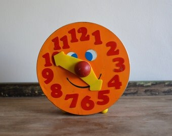 Vintage Toy Tin Clock Toy Bank. Collectible Metal Savings Bank. Coin Piggy Bank. Children Learn Time Clock. Orange Round Tin Box. Industrial