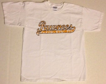 Camp Arrowhead 'PAWNEE' tribe white t-shirt with gold camo script writing!
