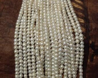 9-12mm White Fresh Water Pearls... 1 Strand