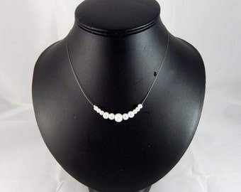 Necklace of white pearls and ivory color