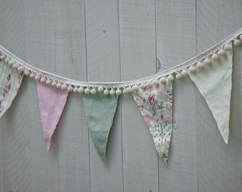 Shabby banner with pompoms