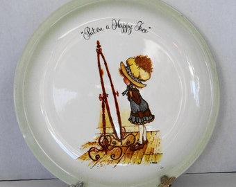"""Vintage 1972 Holly Hobbie Collector's Edition Plate """" Put on a Happy Face"""" with Wall Hanging Plate Holder  by American Greetings Corp."""