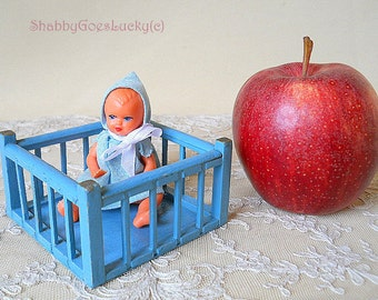 Vintage 1950s dollhouse miniature wooden playpen with marked E.S. Germany dollhouse baby doll in original clothes, old dollhouse furniture