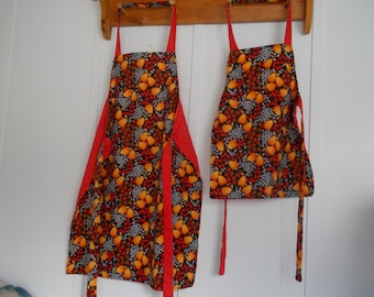 Apron sets, Mommy and me aprons reversible Red with blueberries, strawberries, and oranges