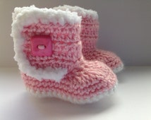 Crochet baby booties. Pink with white fur style trim. For newborn babies.