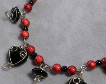Tangerine and black necklace and bracelet set