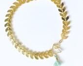 Ilys- Chevron bracelet with tuny mint tassel