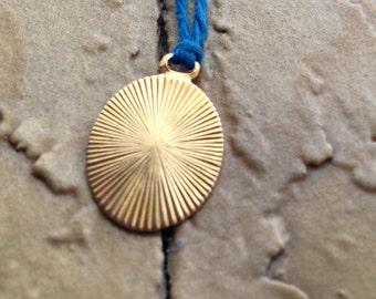 starburst military notion necklace on hemp string
