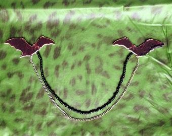 Double bat brooch