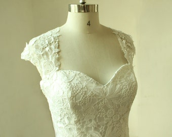 Vintage fit and flare lace wedding dress with keyhole back and capsleevs