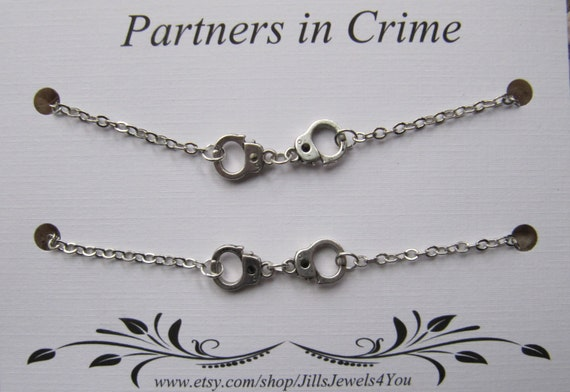 partners in crime bracelet with handcuff charms 2