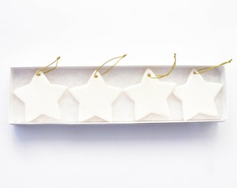 Set of 4 white porcelain stars | Christmas decorations