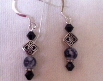 Grey and black silver pierced earrings with Celtic knot beads.