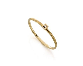 18 carat gold stackable ring with small diamond.