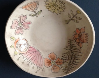 Beautiful ceramic serving bowl with hand engraved flowers