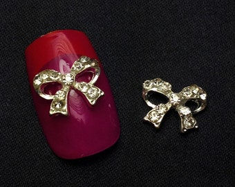 4 Alloy And Rhinestone Bows With Middle Rhinestone 3D Nail Art
