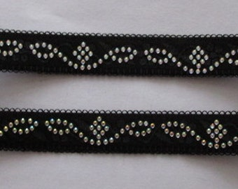 Black wiggly bra strap embellished with tiny jewels. Stretchy adjustable. Will jazz up outfit - will not give support