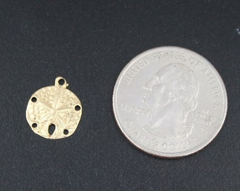 14kt yellow gold Sand Dollar charm .2 grams