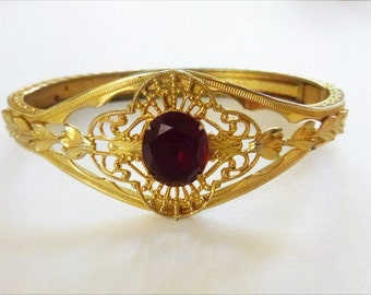 Edwardian open work filigree bangle bracelet with red glass gem and engraved geometric detail