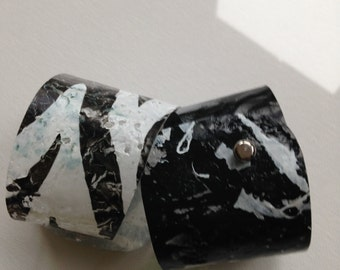 Recycled plastic cuff bracelet in black and white colours