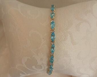 Sky Blue Topaz and Diamond Tennis Bracelet 14k Gold - EB283
