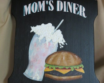 Mom's Diner with strawberry milk shake and cheeseburger on tavern sign