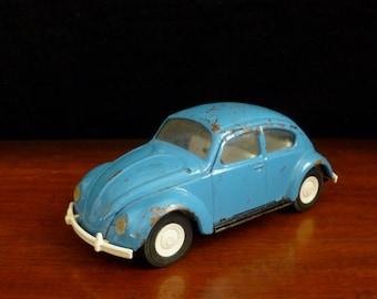 Tonka late 60's VW.   The iconic volkswagon Beetle (already beat up)