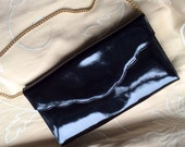 Vintage 70s black patent leather clutch bag with chain strap.