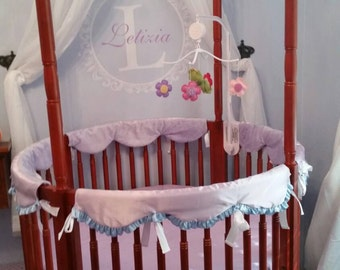Custom made for you and your little one Round Crib set includes, 2 sheets, quilt, upper  bumpers.  Contact me for custom options.
