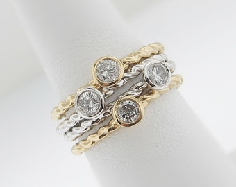 14k gold o.25ct round cut diamond ring in bezel set. stacking ring