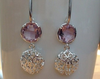 Round silver filigree and mauve crystal earrings
