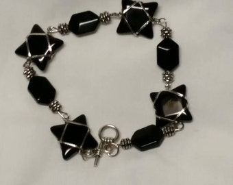 An awesome toggle clasp bracelet done in silver with black glass beads