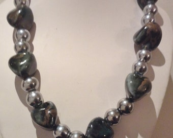 Necklace.52cm Features Large irregular shapeHigh Quality Lampwork Glass beads. Multi shaded. Round Silver Plated spacers