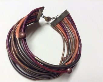 Multi-strand  leather cord bracelet in earth-tone colors