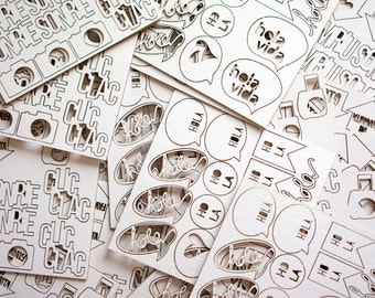 Die-cut cardboard sheets for scrapbooking